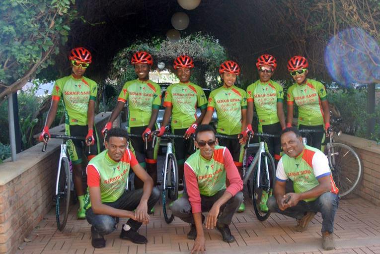 Cycling team Serair Sawa Standing (From left) Betelihem Fetsumberhan, Sandra Ukbay, Danait Yafet, Kisanet Woldemicael, Milena Yafet, Selamawit Haileab Siting (From Left) Fillimon Russom (Team Mechanic), Biniam Tareke (Team Manager), Berket Zere (Coach)